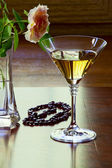Garnet necklace and glass with white wine — Stock Photo