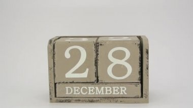 Putting together a wooden calendar showing December, 31 FullHD 1080p — Stock Video