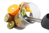 Fresh fruits mixing with hand blender — Stock Photo
