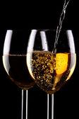 White wine glasses on black — Stock Photo