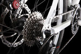 Engrenagens de bicicleta, freio a disco e desviador traseiro. — Foto Stock