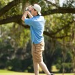 Adolescent Playing Golf - Stock Photo