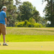Putting for the Win — Stock Photo