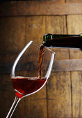 Glass wineThe bottle of red wine and glass and barrel — Stock Photo