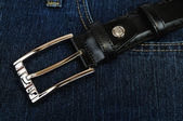 Jeans background with belt — Stock Photo