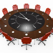 Office chairs and round table with a clock face — Stock Photo