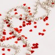 Glitter hearts and pearls — Stock Photo #19701117