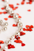 Glitter hearts and pearls — Stock Photo