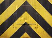 Black and yellow warning stripes — Stock Photo