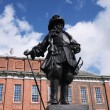 Statue of William III in front of Kensington Palace, London - Stock Photo