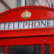 Detail of red phone booth in London - Stock Photo