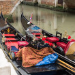 Two gondolas moored along a canal  in Venice — Stock Photo