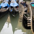 Prows and sterns  of Venetian gondolas — Stock Photo