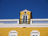 Rooftop window on typical Portuguese building — Stock Photo