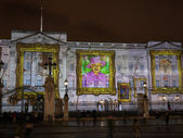Buckingham Palace projection of portraits — Stock Photo
