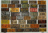 Collection of American and Canadian lisense plates — Stock Photo
