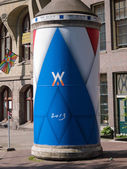 Advertising column in the city of Amsterdam during inauguration — Stock Photo