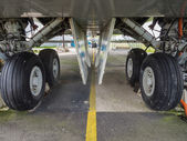 Undercarriage of jumbo jet — Stock Photo