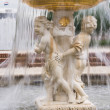 Cherub fountain with blurred water flowing — Foto Stock