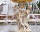 Cherub fountain with blurred water flowing — Stock Photo