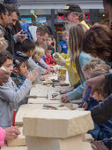 Kids learning to carve at Sculpture Festival — Stock Photo
