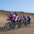 Mountain bikers taking part in beach race Egmond-Pier-Egmond — Stock Photo #38961455