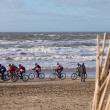 Mountain bikers taking part in beach race Egmond-Pier-Egmond — Stock Photo #38961531