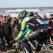 Mountain bikers taking part in beach race Egmond-Pier-Egmond — Stock Photo #38961633