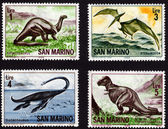 Postage stamps showing dinosaurs — Stock Photo