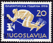 Stamp showing skiing sportsman — Stock Photo
