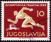 Stamp showing track and field athlete — Stock Photo