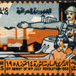 Stock Photo: Postage stamp showing soldier and peope to commemorate revoluti