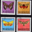 Postage stamps showing several types of butterflies — Stock Photo #40230033