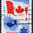 Postage stamp showing globe and Canadiflag — Stock Photo #40230273