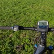 Handlebars of state of the art electric powered mountain bike — Stock Photo #40249505