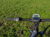 Handlebars of state of the art electric powered mountain bike — Stock Photo