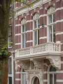 Amsterdam canal house with balcony — Stock Photo