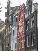 Amsterdam canal houses in different styles — Stock Photo