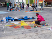 Street painter at work — Stock Photo