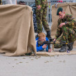 Постер, плакат: Children play with weapons on Army Day