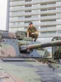 Soldier sitting on tank — Stock Photo