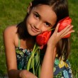 Flower Loving Girl — Stock Photo