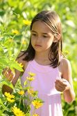Hispanic Girl Enjoys her Garden — Foto de Stock