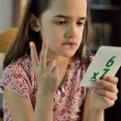 Постер, плакат: Little Hispanic Girl Doing Math