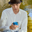 Young Hispanic Man with Smartphone — Stock Photo