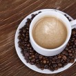Coffee cup with beans — Stock Photo #19734391