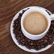 Coffee cup with beans — Stock Photo #19734401