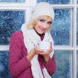 Royalty-Free Stock Photo: Woman in warm clothing with cup