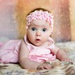 Baby girl in pink dress — Stock Photo #19734727