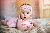 Baby girl in pink dress — Stock Photo